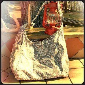 Thirty-one reversible cloth shoulder bag.